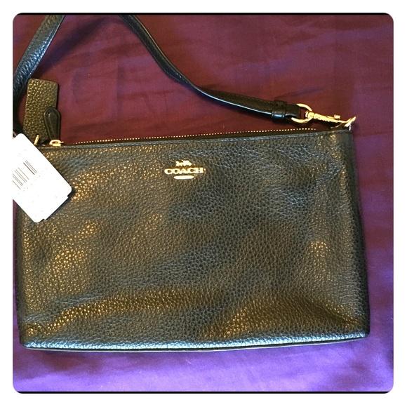 Coach Handbags - Coach black leather clutch/wristlet